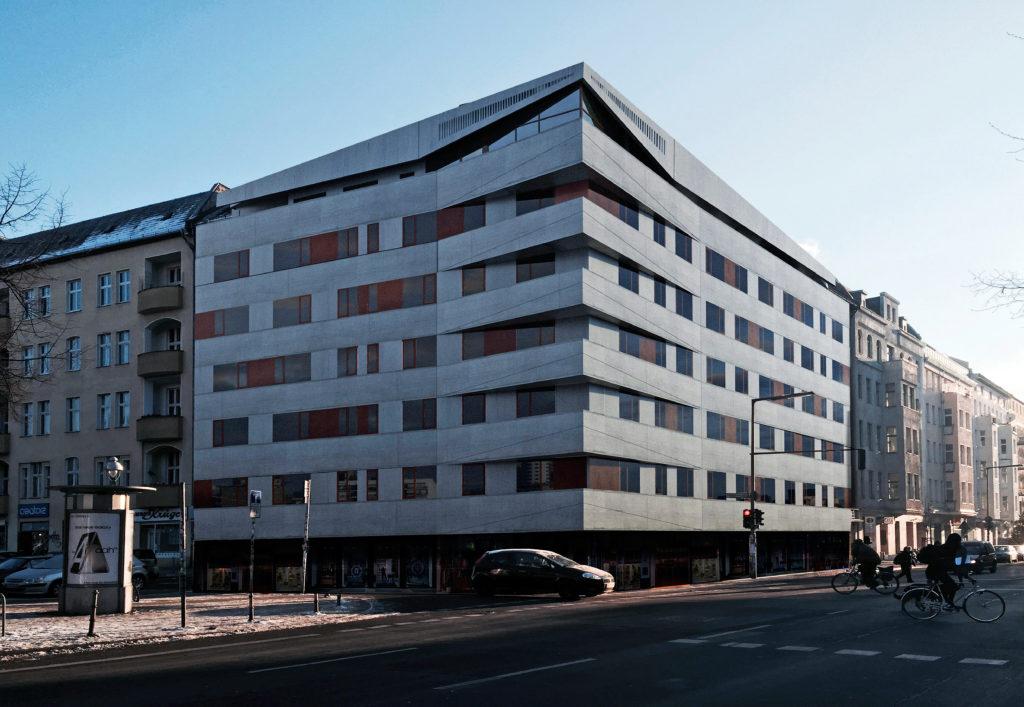 Ristrutturazione di un edificio residenziale a berlino Kreuzberg con realizzazione di una nuova facciata in cemento e corten e ampliamento dell'immobile con la costruzione di 4 nuove penthouse sul tetto dell'edificio esistente